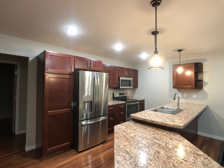 Empire Custom Townhomes Grand Forks with Cherry Cabinets
